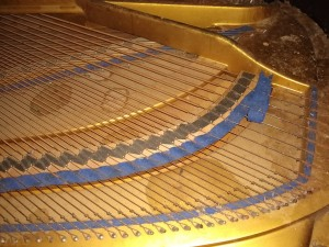Interior of piano before cleaning and polishing